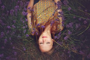 woman lying on ground in lavender